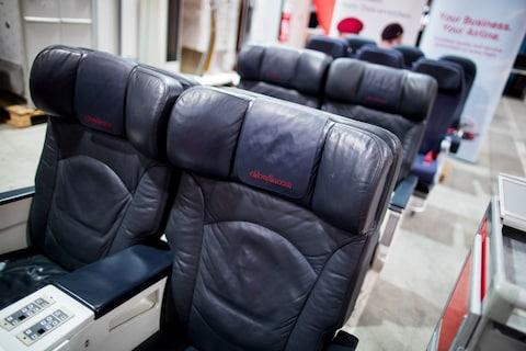 Blue leather business class seats are up for sale in the auction - Credit: Getty