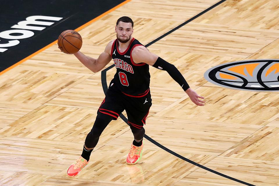 Zach LaVine #8 of the Chicago Bulls controls the ball against the Orlando Magic at Amway Center on February 6, 2021 in Orlando, Florida.