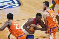 New Orleans Pelicans forward Zion Williamson drives to the basket against Phoenix Suns center Deandre Ayton (22) and forward Frank Kaminsky (8) during the first half of an NBA basketball game in New Orleans, Friday, Feb. 19, 2021. (AP Photo/Gerald Herbert)