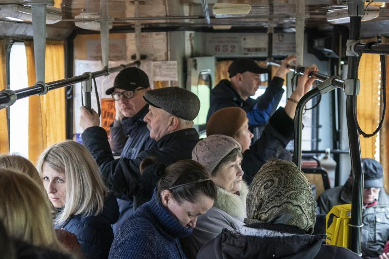 In this photo taken on Monday, April 15, 2019, people ride a trolley bus in Kryvyi Rih, in eastern Ukraine. Residents of the industrial city complain about a low standard of living and soaring utilities bills. Many in the city support Volodymyr Zelenskiy, an actor and comedian from the city, in the runoff election on Sunday, April 21, against President Petro Poroshenko. (AP Photo/Evgeniy Maloletka)