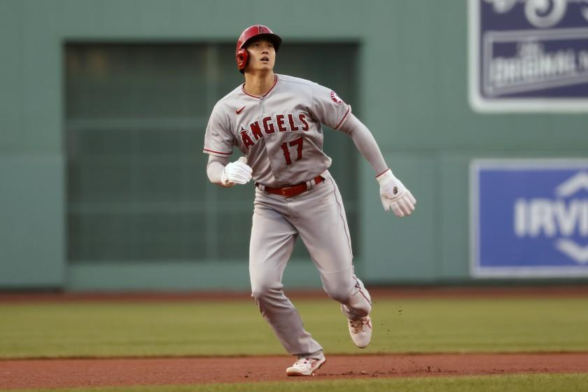 The Angels' Shohei Ohtani doubled and homered as a designated hitter against Boston on Friday.