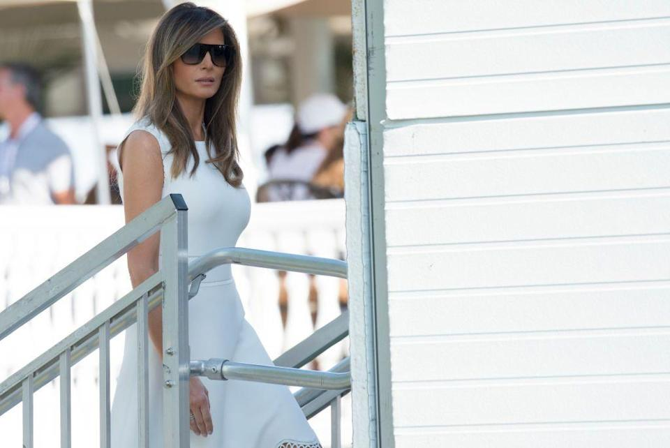 """<p>Melania paired a fitted white dress with oversized sunglasses at the Women's Open Golf Championship at <a href=""""https://www.townandcountrymag.com/leisure/travel-guide/g9542605/trump-national-bedminster-things-to-know/"""" rel=""""nofollow noopener"""" target=""""_blank"""" data-ylk=""""slk:Trump National Golf Course in Bedminster"""" class=""""link rapid-noclick-resp"""">Trump National Golf Course in Bedminster</a> over the weekend. At this point, Trump has visited his family's business properties more than 50 times over the course of his presidency.</p>"""
