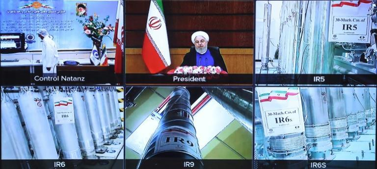 A screen grab from a videoconference shows views of centrifuges and devices at Iran's Natanz uranium enrichment plant, as well as Iran's President Hassan Rouhani delivering a speech