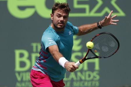 Mar 25, 2017; Miami, FL, USA; Stan Wawrinka of Switzerland hits a backhand against Horacio Zeballos of Argentina (not pictured) on day five of the 2017 Miami Open at Crandon Park Tennis Center. Wawrinka won 6-3, 6-4. Mandatory Credit: Geoff Burke-USA TODAY Sports