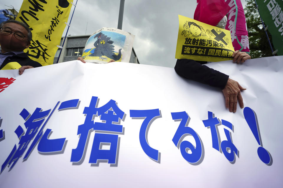 "People hold a banner that partially reads ""Don't dump into the sea"" during a rally outside the prime minister's office in Tokyo Tuesday, April 13, 2021. Japan's government decided Tuesday to start releasing massive amounts of treated radioactive water from the wrecked Fukushima nuclear plant into the Pacific Ocean in two years, an option fiercely opposed by local fishermen and residents. (AP Photo/Eugene Hoshiko)"