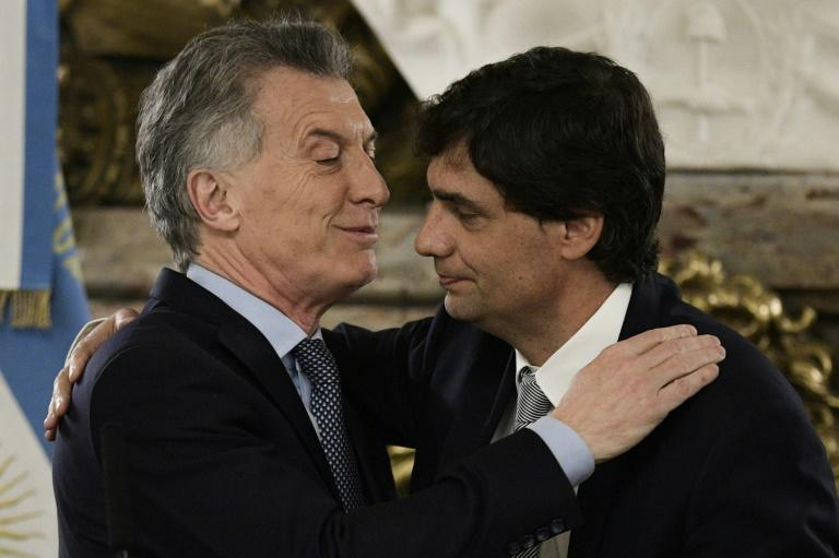 Argentina's President Mauricio Macri (L) congratulating his new finance minister Hernan Lacunza, who now faces the task of stabilizing Argentina's currency