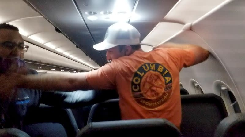 Men scuffle on a Frontier Airlines flight from Philadelphia to Miami