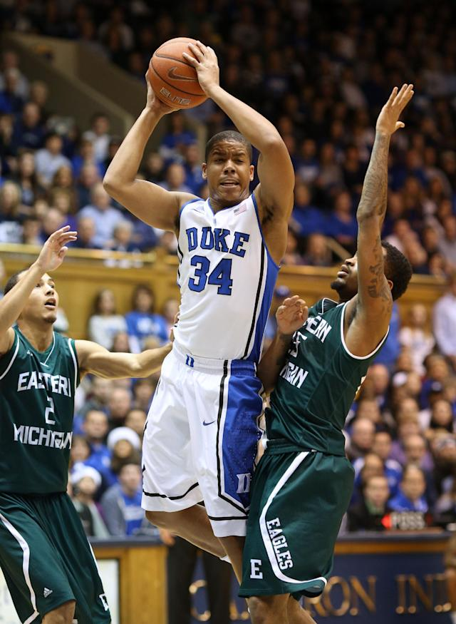 Duke's Andre Dawkins (34) tries to drive around the defense of Eastern Michigan's J.R. Sims (2) and Darrell Combs during the first half of an NCAA college basketball game in Durham, N.C., Saturday, Dec. 28, 2013. (AP Photo/Erik Perel)