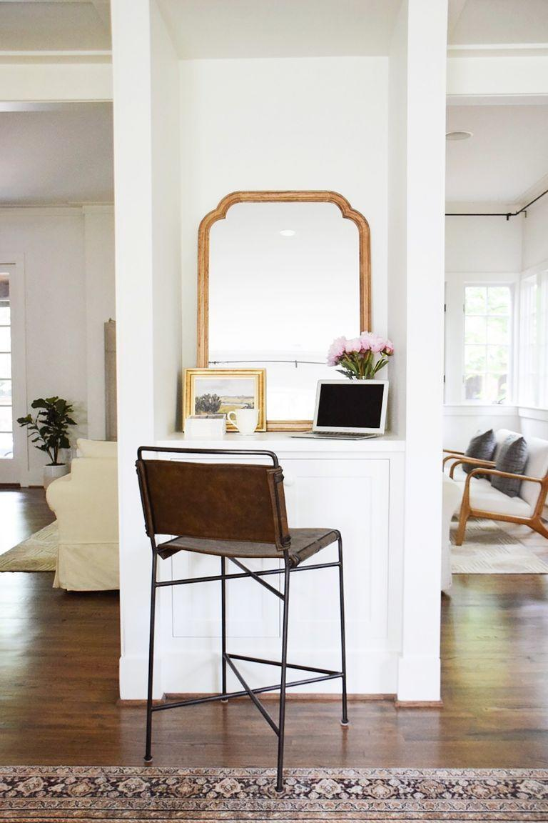 "<p>If you don't have the luxury of dedicating an entire room to an office setup, a simple nook can get the job done. Pair a high stool with a compact tabletop and use a mirror, art, and a small floral arrangement to really make the space your own.</p><p><strong>RELATED:</strong> <a href=""https://www.goodhousekeeping.com/home/decorating-ideas/g1917/decor-ideas-study/"" rel=""nofollow noopener"" target=""_blank"" data-ylk=""slk:30 Brilliant Home Office Ideas to Boost Your Creativity"" class=""link rapid-noclick-resp"">30 Brilliant Home Office Ideas to Boost Your Creativity</a></p>"