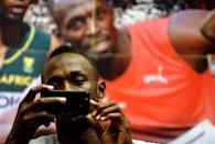 Jamaican sprinter Usain Bolt takes a picture during a news conference before the Ostrava Golden Spike athletics meeting in Ostrava, Czech Republic, June 26, 2017. REUTERS/David W Cerny