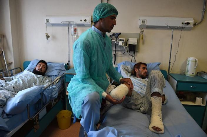 Medical staff treat wounded Afghan National Army soldiers at Sardar Mohammed Daoud Khan Military Hospital in Kabul (AFP Photo/Wakil Kohsar)