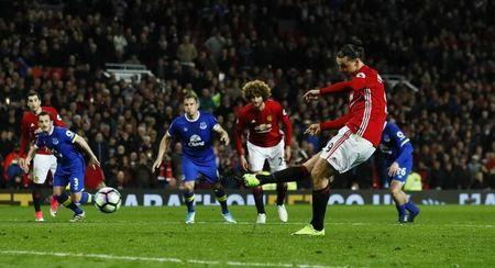 Manchester United's Zlatan Ibrahimovic scores their first goal from the penalty spot
