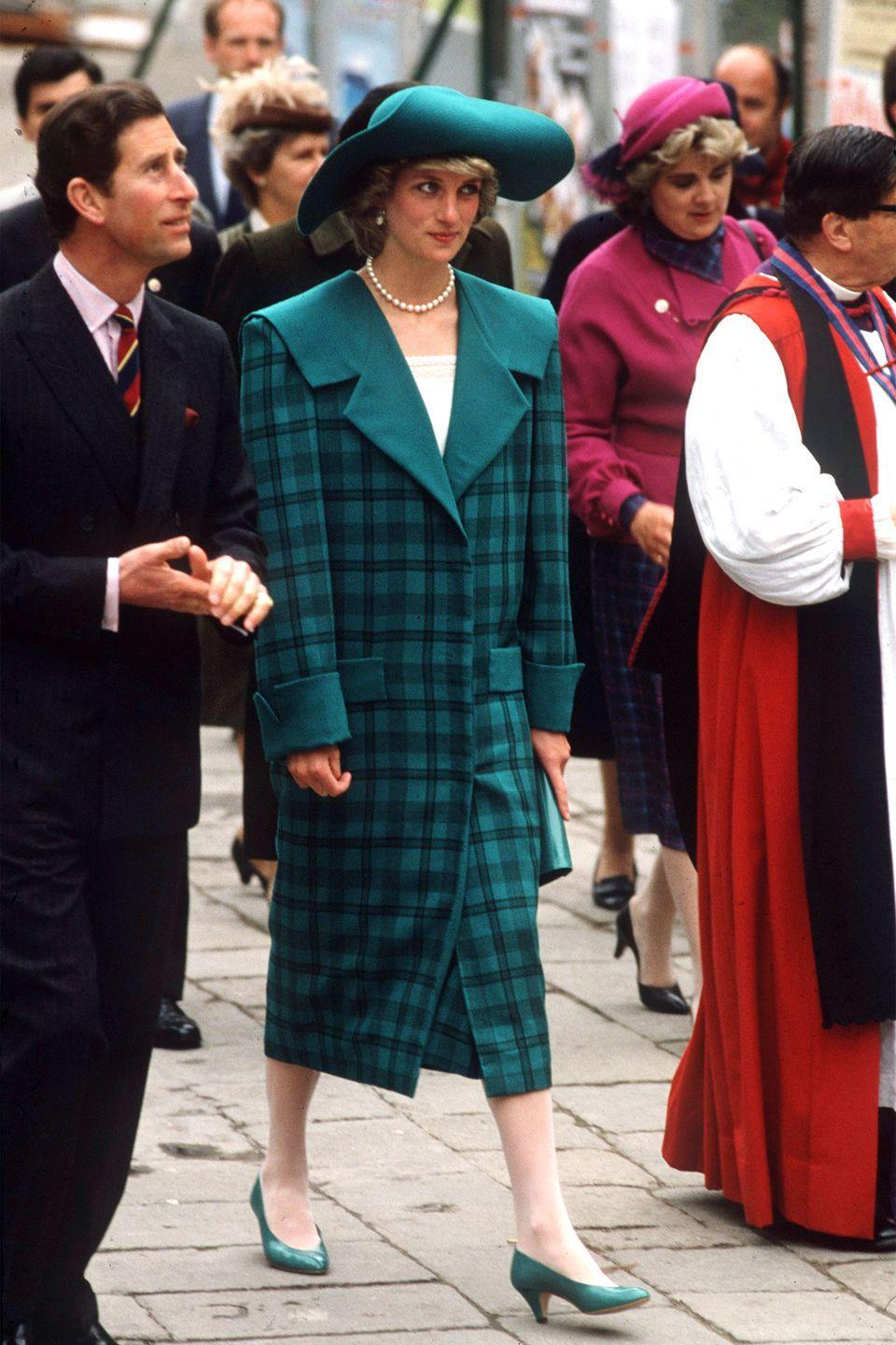 <p>Wearing a checkered coat by David and Elizabeth Emanuel while visiting Venice with Prince Charles. </p>