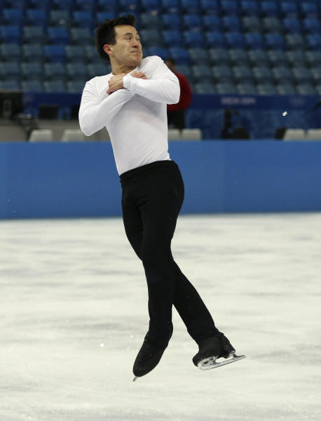 Patrick Chan of Canada practices during a figure skating practice session at the Iceberg Skating Palace ahead of the 2014 Winter Olympics, Monday, Feb. 3, 2014, in Sochi, Russia. (AP Photo/Mark Baker)