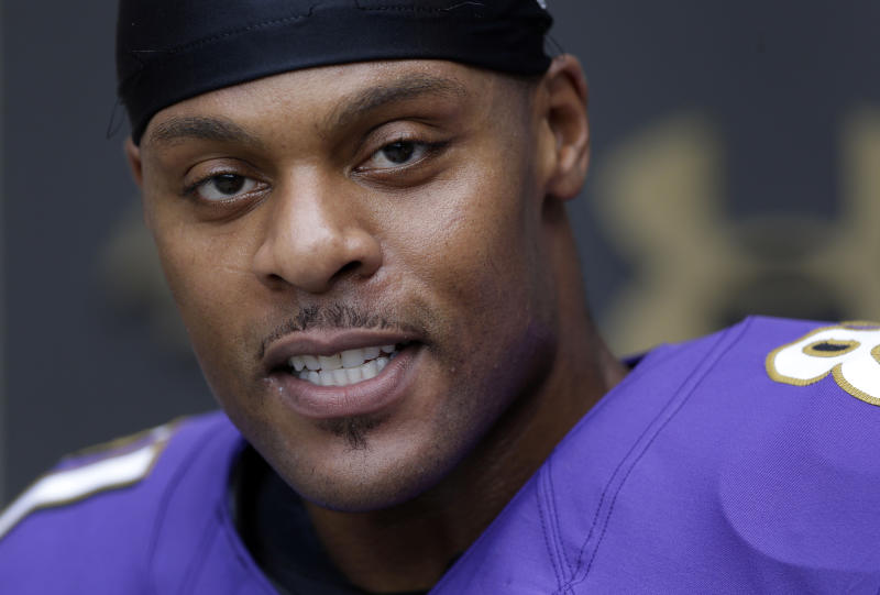 Baltimore Ravens tight end Visanthe Shiancoe speaks at a news conference after NFL football training camp at the team's practice facility in Owings Mills, Md., Sunday, July 28, 2013. (AP Photo/Patrick Semansky)