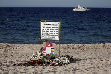 FILE PHOTO: A plaque dedicated to victims is pictured on the beach of the Imperial Marhaba resort, on the first anniversary of an attack by a gunman at the hotel in Sousse, Tunisia June 26, 2016.  REUTERS/Zohra Bensemra/File Photo
