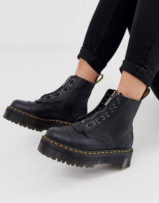"""<p><strong>Dr Martens</strong></p><p>us.asos.com</p><p><strong>$205.00</strong></p><p><a href=""""https://go.redirectingat.com?id=74968X1596630&url=https%3A%2F%2Fwww.asos.com%2Fus%2Fdr-martens%2Fdr-martens-sinclair-flatform-zip-leather-boots-in-tumbled-black%2Fprd%2F12792571&sref=https%3A%2F%2Fwww.townandcountrymag.com%2Fstyle%2Ffashion-trends%2Fg35155148%2F2021-shoe-trends%2F"""" rel=""""nofollow noopener"""" target=""""_blank"""" data-ylk=""""slk:Shop Now"""" class=""""link rapid-noclick-resp"""">Shop Now</a></p>"""