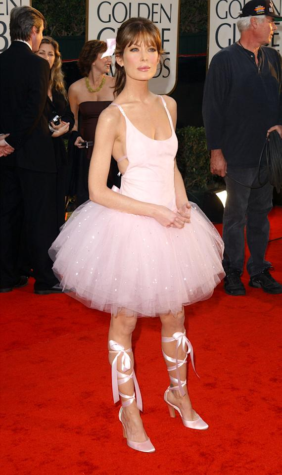 Worst froufrou tutu: Lara Flynn Boyle There were so many angles of wrong in Lara Flynn Boyle's backless pink tutu by David Cardona. Childhood regression? Sexualizing a tutu? Or that she looked like a bobblehead doll? Her 2003 ballerina dominatrix look also emphasized rumors that she had lost too much weight. As for pulling off pink, wear it like Emily Blunt (2010), Natalie Portman (2011), or Jessica Alba (2012).
