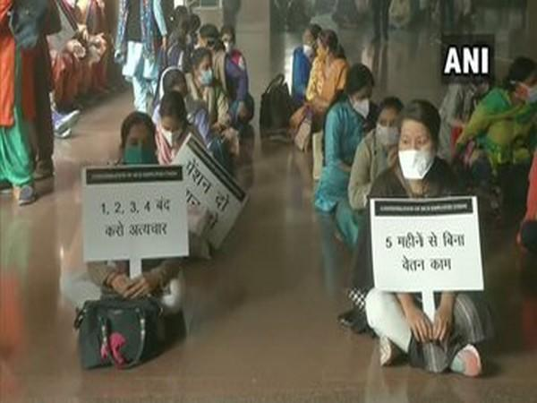 MCD employees protesting at the CIvic Centre on Tuesday.