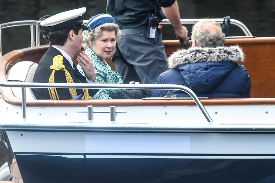 MACDUFF, SCOTLAND - AUGUST 02: Imelda Staunton and other cast members are seen on a boat made to look like a Royal yacht tender in the harbour during filming for the Netflix series