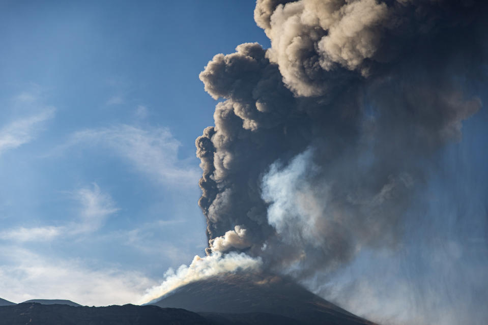 An ash column rises during an eruption of Mt. Etna, Europe's largest active volcano, as seen from the Bove Valley of Etna Park, on the eastern slope of Mt. Etna, in Sicily, southern Italy, Sunday, July 4, 2021. Since Feb. 16, 2021, Mt. Etna has begun a series of eruptive episodes. (AP Photo/Salvatore Allegra)