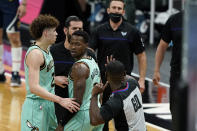 Referee James Williams (60) throws Charlotte Hornets coach James Borrego out of the game during the second half of an NBA basketball game against the Denver Nuggets on Tuesday, May 11, 2021, in Charlotte, N.C. (AP Photo/Chris Carlson)