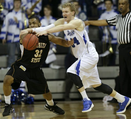 Wichita State guard Tekele Cotton, left, steals the ball from Drake forward Ben Simons during the first half of an NCAA college basketball game on Wednesday, Jan. 2, 2013, in Des Moines, Iowa. (AP Photo/Charlie Neibergall)