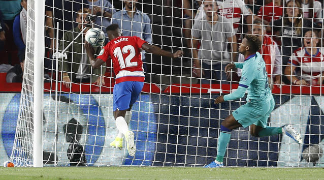Granada's Ramon Azeez scores against Barcelona during the Spanish La Liga soccer match between Barcelona and Granada at the Los Carmenes stadium in Granada, Spain, Saturday, Sept. 21, 2019. (AP Photo/Miguel Morenatti)