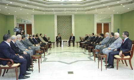 Syria's President Bashar al-Assad meets members of the General Secretariat of the Arab Parties' General Conference in Damascus