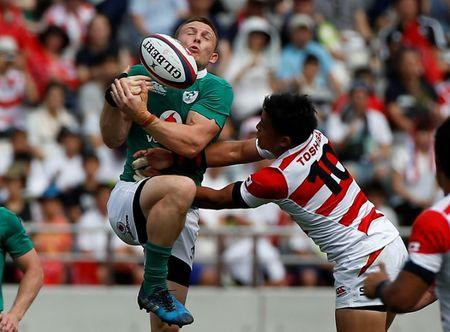 Rugby Union - Japan v Ireland - Ajinomoto Stadium, Tokyo, Japan - June 24, 2017 - Ireland's Andrew Conway and Japan's Jumpei Ogura in action. REUTERS/Issei Kato