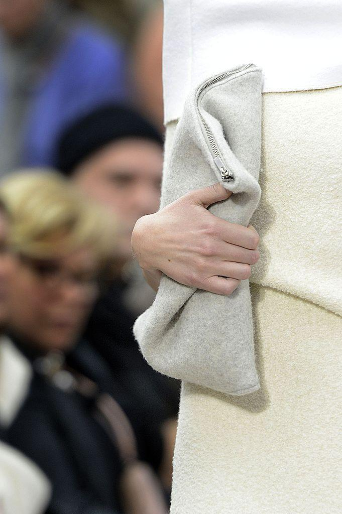 <p>Take one look at a recent street-style gallery and you'll see Bottega Veneta's pillowy pouches trending in every city. (It's no coincidence that Daniel Lee, the brand's creative director, once worked under Philo at Céline).</p><p>Philo first put them on the runway as part of Céline's AW13 collection, and not only did she put the style in the spotlight, but she inspired a new way of carrying them - those models really clutched those clutches.</p>