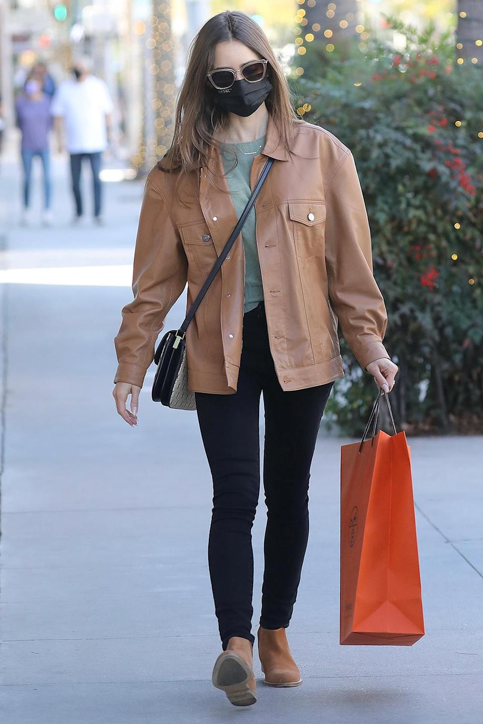 <p>Lily Collins gets some retail therapy in at the L.A. Hermès store.</p>
