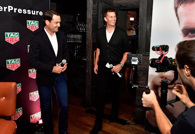 Kilian Muller, CEO of TAG Heuer North America, left, and New England Patriots quarterback Tom Brady attend the unveiling of the TAG Brady's Limited Edition Carrera Watch at the Scampo restaurant at the Liberty Hotel in Boston, Sept. 24, 2017. (Photo: Paul Marotta/Getty Images for TAG Heuer)