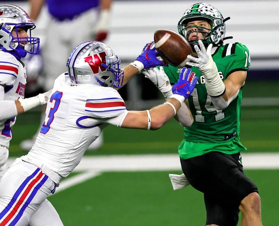 Southlake Carroll receiver Brady Boyd (14) come up with a nice catch against Austin Westlake defensive back Lucas Mireur (3) during the second half of the 6A Division 1 High School State Championship football playoff game, January 16, 2021 played at AT&T Stadium in Arlington, Tx. (Steve Nurenberg Special to the Star-Telegram)