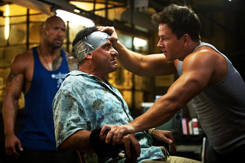 "This undated publicity photo released by Paramount Pictures shows, from left, Dwayne Johnson as Paul Doyle, Tony Shalhoub as Victor Kershaw and Mark Wahlberg as Daniel Lugo, in the film, ""Pain and Gain,"" directed by Michael Bay from Paramount Pictures. The film releases in theaters April 26, 2013. (AP Photo/Paramount Pictures, Jaimie Trueblood)"