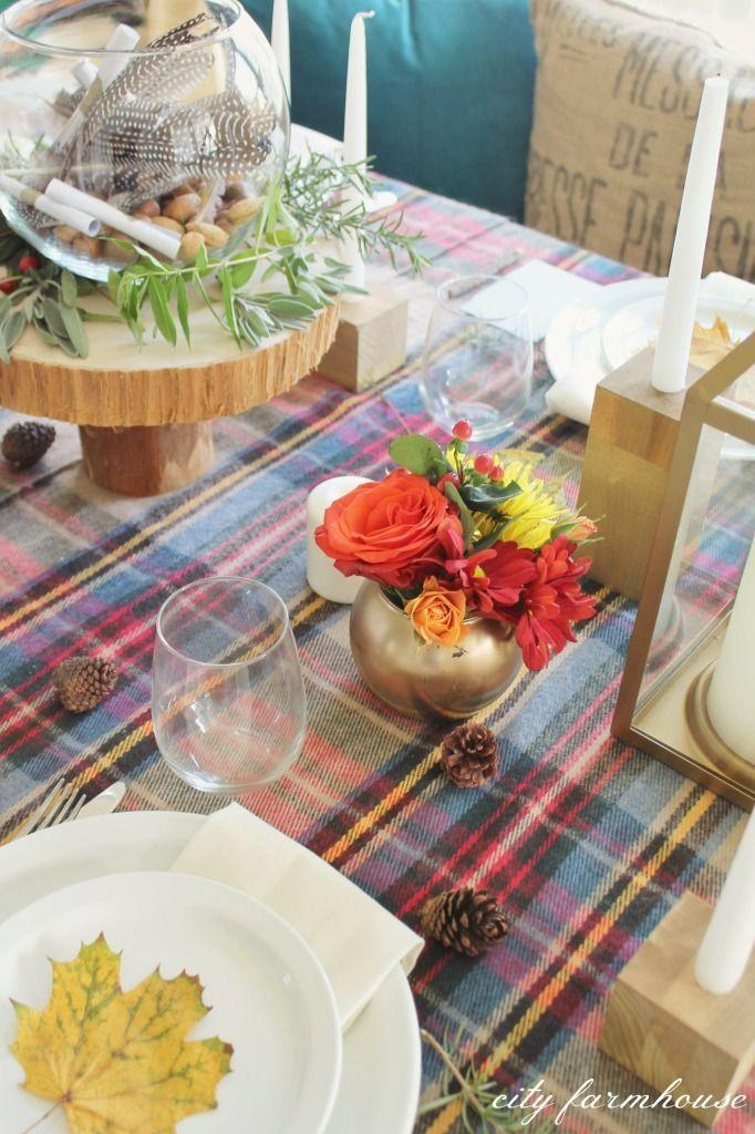 """<p>Blogger Jen covered her table in tartan scarves, then spray-painted vases from the Dollar Store to complement the pattern. She made the rustic wood slice cake stand herself, then topped it with a feather-filled vase.</p><p><strong>Get the tutorial at <a href=""""http://cityfarmhouse.com/2014/11/thanksgiving-tablescape-hop.html"""" rel=""""nofollow noopener"""" target=""""_blank"""" data-ylk=""""slk:City Farmhouse"""" class=""""link rapid-noclick-resp"""">City Farmhouse</a>.</strong></p><p><strong><strong><a class=""""link rapid-noclick-resp"""" href=""""https://www.amazon.com/slp/gourd-decorations/5ct8qwd5uto49bg?tag=syn-yahoo-20&ascsubtag=%5Bartid%7C10050.g.2130%5Bsrc%7Cyahoo-us"""" rel=""""nofollow noopener"""" target=""""_blank"""" data-ylk=""""slk:SHOP DECORATIVE GOURDS"""">SHOP DECORATIVE GOURDS</a></strong><br></strong></p>"""