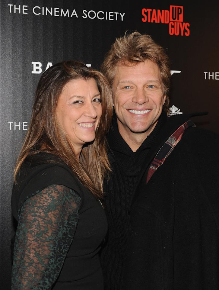 "NEW YORK, NY - DECEMBER 09:  Dorothea Hurley and her husband musician Jon Bon Jovi (R) attend the premiere of ""Stand Up Guys"" hosted by The Cinema Society with Chrysler and Bally at MOMA on December 9, 2012 in New York City.  (Photo by Fernando Leon/Getty Images)"
