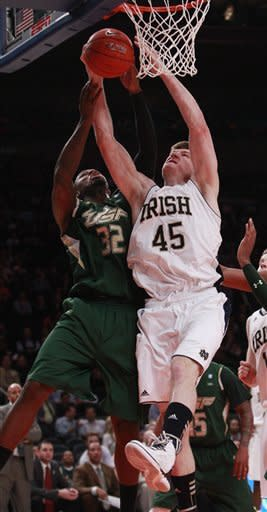 Notre Dame's Jack Cooley (45) and South Florida's Toarlyn Fitzpatrick (32) fight for a rebound during the first half of an NCAA college basketball game in the quarterfinals of the Big East Conference tournament in New York, Thursday, March 8, 2012. (AP Photo/Frank Franklin II)
