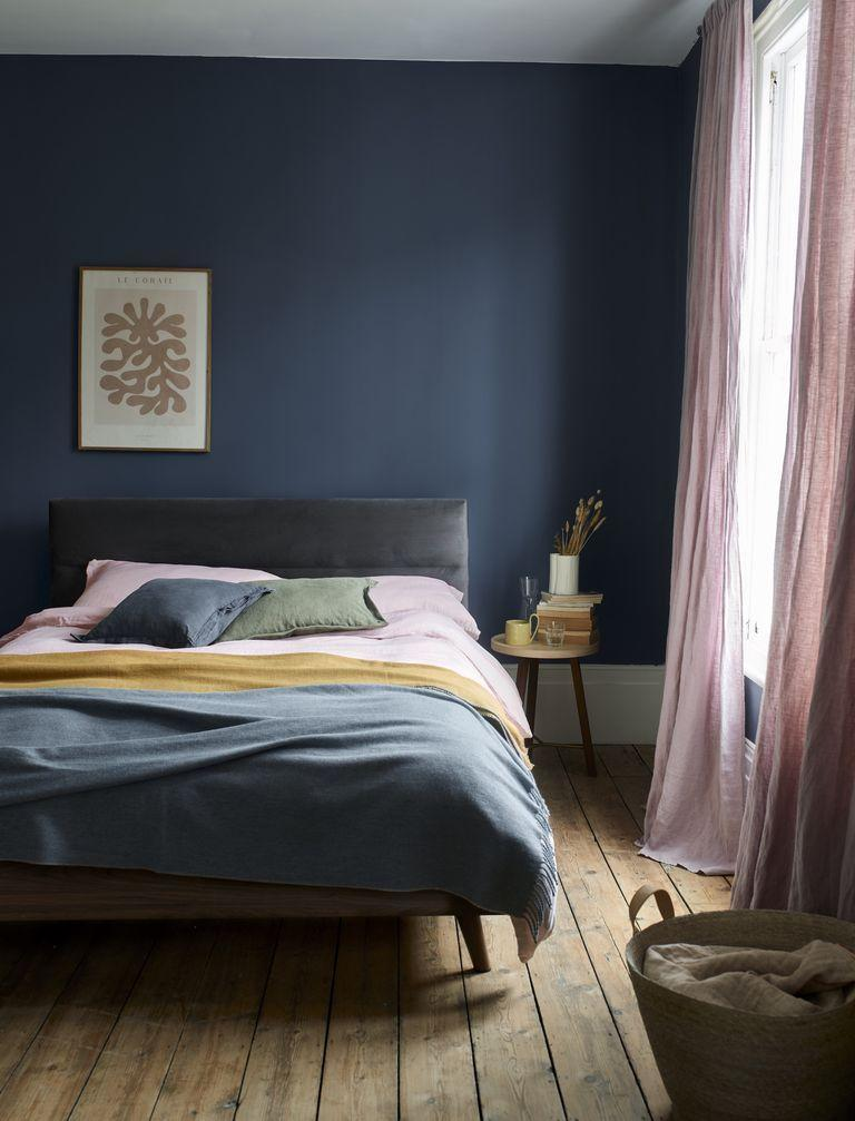 """<p>While pink and grey are a match made in heaven, it doesn't mean you can't play around with other colours. Navy blue, as seen here for example, creates a cocooning effect in the bedroom. Keep your accessories pretty in pink, opt for a grey bed frame, and then bring in a stark contrast with deep blue walls. </p><p>• Maisy ottoman bed frame, <a href=""""https://www.dreams.co.uk/maisy-upholstered-ottoman-bed-frame/p/251-00384"""" rel=""""nofollow noopener"""" target=""""_blank"""" data-ylk=""""slk:House Beautiful collection at Dreams"""" class=""""link rapid-noclick-resp"""">House Beautiful collection at Dreams</a></p>"""