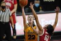 Iowa guard Caitlin Clark (22) drives to the basket ahead of Ohio State guard Braxtin Miller (10) during the first half of an NCAA college basketball game Wednesday, Jan. 13, 2021, in Iowa City, Iowa. Clark, an in-state recruit from West Des Moines Dowling High School, came to the Hawkeyes as a five-star recruit rated No. 4 nationally by ESPN. She won gold medals with the United States team at the 2017 U16 FIBA Americas Tournament and 2019 U19 FIBA World Cup Tournament. It didnt take long for the Hawkeyes to get to know her. (AP Photo/Charlie Neibergall)