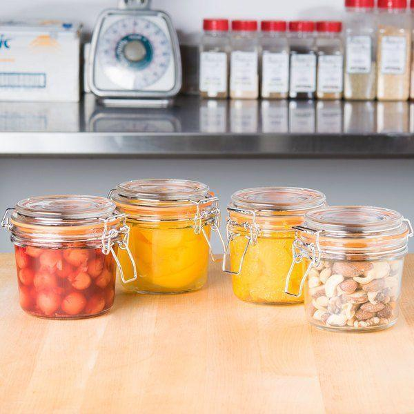 """<p><strong>Tablecraft Glass Condiment Pack</strong></p><p>webstaurantstore.com</p><p><strong>$10.64</strong></p><p><a href=""""https://go.redirectingat.com?id=74968X1596630&url=https%3A%2F%2Fwww.webstaurantstore.com%2Ftablecraft-cjs12-11-5oz-glass-condiment-pack%2F808CJS12.html&sref=https%3A%2F%2Fwww.redbookmag.com%2Fhome%2Fg35380342%2Fhow-to-organize-a-fridge%2F"""" rel=""""nofollow noopener"""" target=""""_blank"""" data-ylk=""""slk:BUY NOW"""" class=""""link rapid-noclick-resp"""">BUY NOW</a></p><p>Canned goods, homemade sauces, and any fermented goods should be kept in glass jars in the side door or on the highest shelf, where they don't need the same height that other products require.</p><p><strong>And voilà! Your fridge is now organized. </strong></p>"""