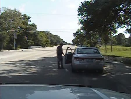 Still image of Texas state trooper Brian Encinia opening the driver's side door as he orders Sandra Bland out of her vehicle in Prairie View