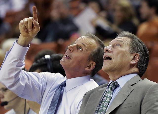 Texas coach Rick Barnes, left, and Michigan State coach Tom Izzo, right, talk before an NCAA college basketball game, Saturday, Dec. 21, 2013, in Austin, Texas. (AP Photo/Eric Gay)