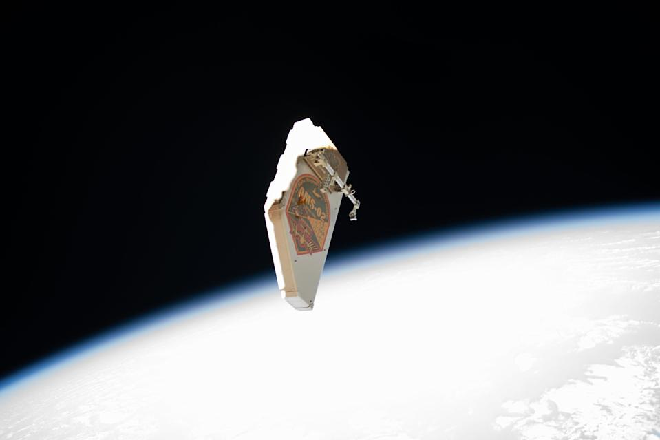 The debris shield that once protected NASA's Alpha Magnetic Spectrometer from micrometeoroid impacts floats away from the International Space Station after two astronauts removed it and flung it into space during a spacewalk on Nov. 15. European Space Agency astronaut Luca Parmitano used special tools to remove 13 screws and 10 fasteners to release the debris shield, after which NASA astronaut Drew Morgan jettisoned the shield, tossing it toward Earth to burn up in the atmosphere. This was the first of four spacewalks that these two astronauts are conducting to repair the ailing particle detector experiment, which was not designed to be serviced by astronauts in orbit, making these some of the most challenging spacewalks ever.