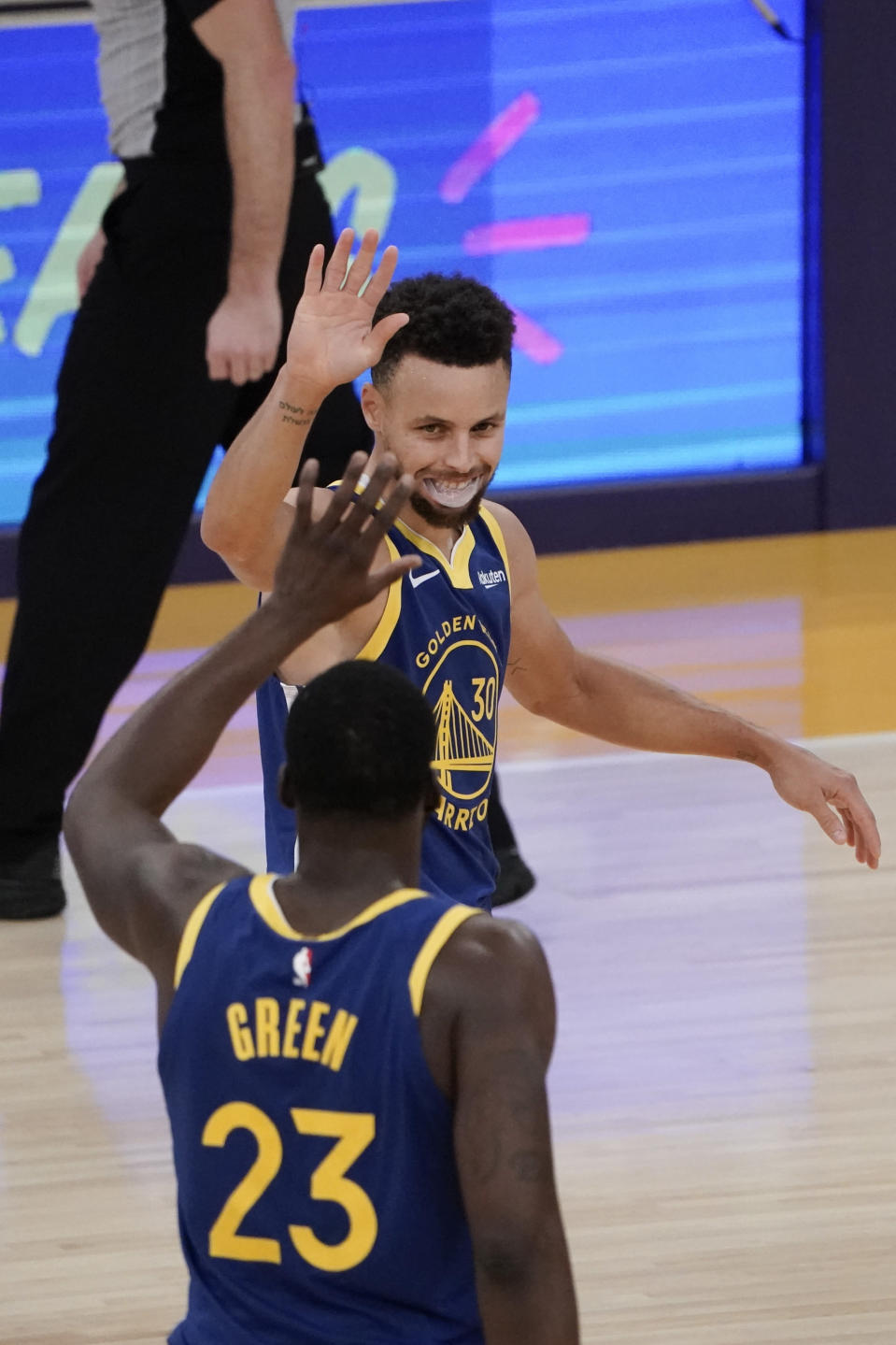 Golden State Warriors' Stephen Curry, top, celebrates a basket by Draymond Green during the second half of an NBA basketball game against the Los Angeles Lakers, Monday, Jan. 18, 2021, in Los Angeles. The Warriors won 115-113. (AP Photo/Jae C. Hong)