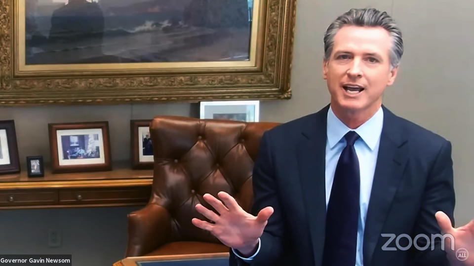 This image taken from a video news conference provided by the Office of California Gov. Gavin Newsom shows California Gov. Gavin Newsom talking on a conference call after signing a new law in Sacramento, Calif. on Monday, Oct. 4, 2021. Newsom signed the law aiming to address the disparity in deaths among Black pregnant women. Black mothers were six times more likely to die within a year of pregnancy than white women in California from 2014 to 2016, the most recent time frame for which data is available. (Office of California Gov. Gavin Newsom via AP)