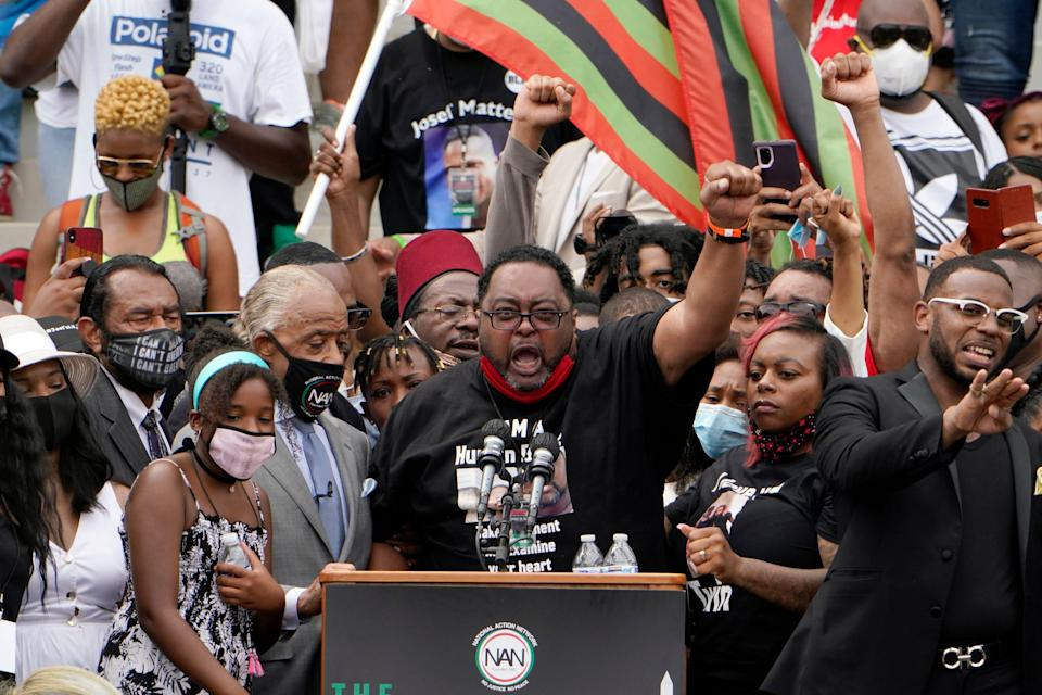 jacob blake sr raises a fist with supporters at a demonstration at the Lincoln Memorial in Washington