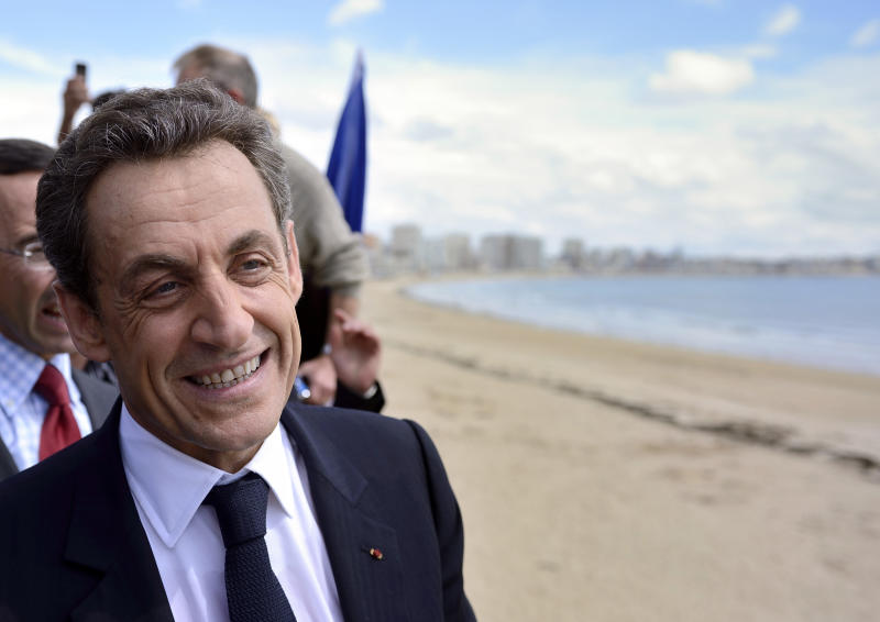 France's incumbent President and Union for a Popular Movement (UMP) party candidate for the French 2012 presidential election, Nicolas Sarkozy, strolls along the sea front after his last campaign meeting in Les Sables-d'Olonne, western France, Friday, May 4, 2012, two days ahead of the second round of the French presidential elections. (AP Photo/Erci Feferberg, Pool)