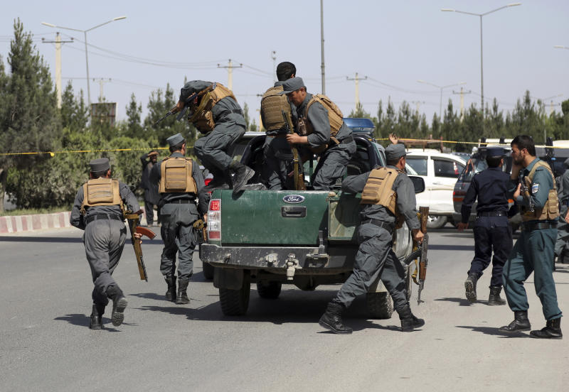 FILE - In this May 30, 2018, file photo, Afghan Security personnel arrive at the site of deadly attack on the interior ministry, in Kabul, Afghanistan. As the Trump administration pushes for peace in Afghanistan, a new U.S. watchdog report says Afghan security forces are shrinking, gaps in security are growing, and the Taliban are largely holding their own despite a surge in American bombing. (AP Photo/Rahmat Gul, File)