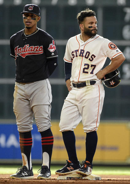 Houston Astros' Jose Altuve (27) waits out a review of his ground-rule double with Cleveland Indians shortstop Francisco Lindor during the seventh inning of a baseball game against the Cleveland Indians, Saturday, May 19, 2018, in Houston. (AP Photo/Eric Christian Smith)